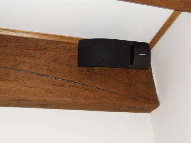 Bose wall speaker hidden behind beams